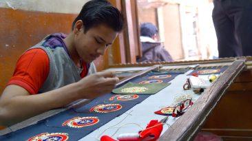 Artisan Making Zardozi Badges